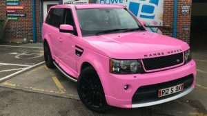 vehicle wrapping pink landrover